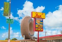 Tecken för Donuts för ` s för värld berömt kåt arkivfoto