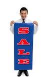 tecken för holdingmanförsäljning royaltyfri bild