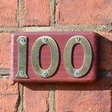 Tecken för husnummer 100 Arkivbilder