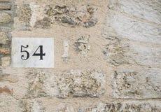 Tecken för husnummer 54 Arkivbild