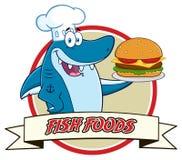 Tecken för kockBlue Shark Cartoon maskot som rymmer en stor hamburgare över ett bandbaner stock illustrationer