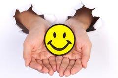 Tecken för leende för kvinnahandinnehav Royaltyfri Fotografi