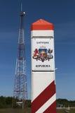 Tecken för Lettland landsgräns Royaltyfri Foto