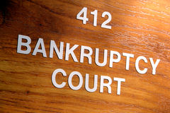 tecken för lokal för konkursdomstolingång Arkivfoto