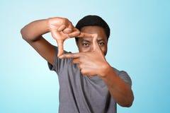 Tecken för ram för afrikansk amerikanmandanande arkivfoton
