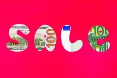 Tecken för Sale dollar/euro på en röd bakgrund Royaltyfri Bild