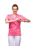 Tecken för sjuksköterskavisninghjärta på vit Arkivbild