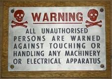 Tecken för tappningmetallvarning Royaltyfri Fotografi
