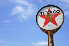 Tecken för tappningTexaco olja Arkivbilder