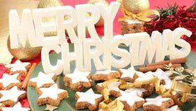 tecken för kanelbruna kakor för jul glatt Arkivfoton