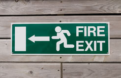 Tecken för brandutgång Arkivfoto