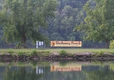 Tecken för gemenskap för semesterort för Rockaway strandfamilj Arkivfoto
