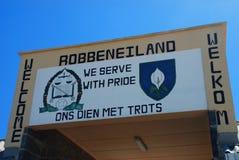Tecken för ingång för Robben öfängelse Sikten över stad och tabellberg från seaa sid Västra udd, Sydafrika Arkivbilder