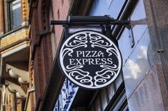 Tecken och logo för pizza uttryckligt royaltyfri foto