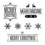 Tecken och ramar för glad jul dekorativt med snöflingor Royaltyfria Bilder