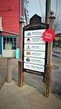 Tecken till den dagliga öppna Yukon saluhallen arkivfoto