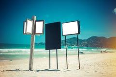 Teckenbräden på stranden Royaltyfria Bilder