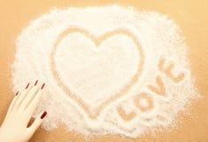 Teckna med den vita sanden Royaltyfri Foto