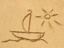 Teckna på sanden Arkivfoto