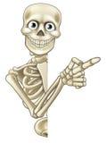 Tecknad film som pekar skelettet Arkivfoto