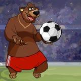 Tecknad filmbjörn i kortslutningar och med en fotbollboll Arkivfoton