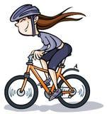 Tecknad filmflicka på cykeln. Arkivfoto
