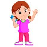 Tecknad filmflicka som använder en smart telefon stock illustrationer