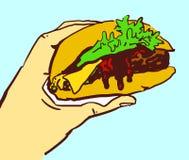 Tecknad filmhand med ostburgaren Arkivfoto