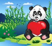 tecknad filmhjärta som rymmer den utomhus- pandaen Royaltyfria Bilder