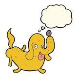 tecknad filmhund som ut klibbar tungan med tankebubblan Arkivbild
