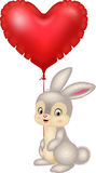 Tecknad filmkanin som rymmer röda hjärtaballonger Arkivfoto