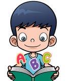 Tecknad filmpojke som läser en bok Royaltyfri Bild