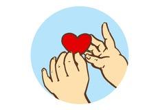 Tecknade filmen behandla som ett barn händer som rymmer liten röd hjärta Fotografering för Bildbyråer