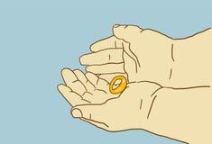 Tecknade filmen guld- gifta sig Ring Is On A gömma i handflatan av händer Arkivfoto