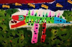 tecknande faderson Den målade väggen i barnets rum målade vid pojken själv med draken Arkivfoto