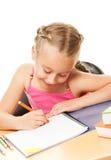 tecknande liten schoolgirl Fotografering för Bildbyråer