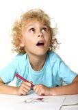 tecknande unge little som tänker Fotografering för Bildbyråer