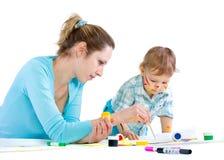 tecknar barn för mummålarfärgson Royaltyfria Bilder
