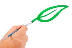 tecknar den gröna handleafen arkivbilder