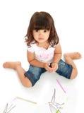 tecknar den little nätt flickan arkivbild