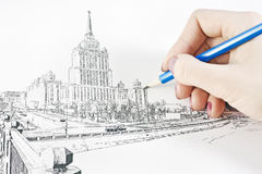 tecknar den stads- handligganden arkivfoto