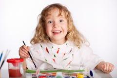 tecknar flickamålarfärg royaltyfria bilder