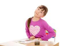 tecknar flickamålarfärger arkivfoto