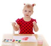 tecknar flickamålarfärger arkivbilder