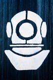 Tecknet, ett symbol av den industriella dykare Arkivfoto