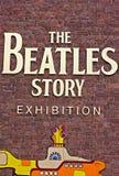 Tecknet för Beatles berättelseutställning Arkivbild