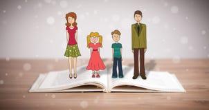 Teckning av en lycklig familj på den öppnade boken Arkivbild
