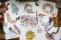 Teckningar av olika julsymboler och tecken Arkivfoton