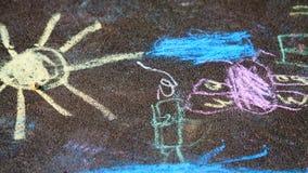 Teckningar för barn` s på trottoaren Royaltyfria Bilder