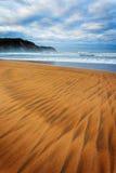 Teckningar i sanden på en strand Arkivbild